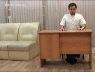 Упражнения за офисным столом: сжимаем кулаки